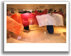 Students learning veil work at a bellydancing class